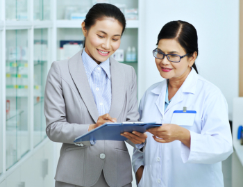 pharmacist and a woman talking