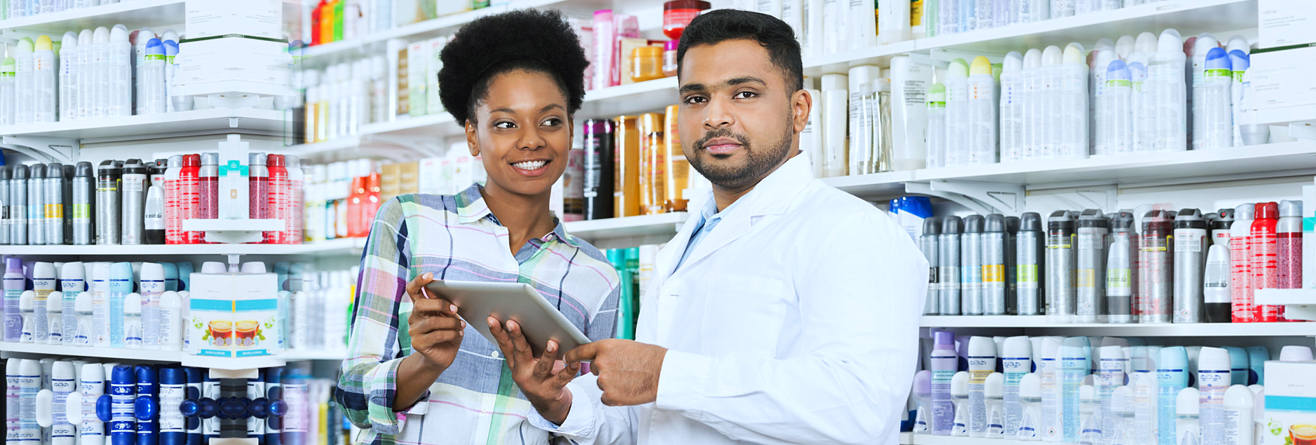 pharmacist and a smiling customer
